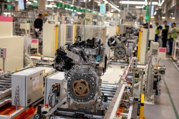 Toyota is starting the production of hybrid drive engines in a modern factory with automatic internal transport